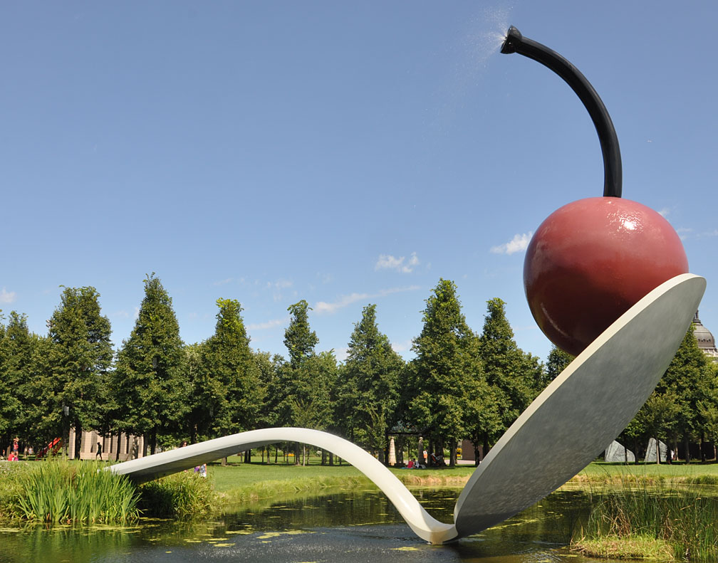 The spoonbridge and cherry was created and installed in 1988 the stainless steel and aluminum sculpture is approximately 29 feet long and 13 feet tall
